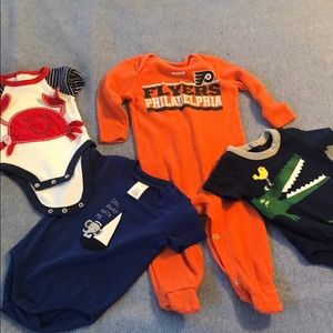 Onesies pack. Range in size from 3 mos to 9 mos